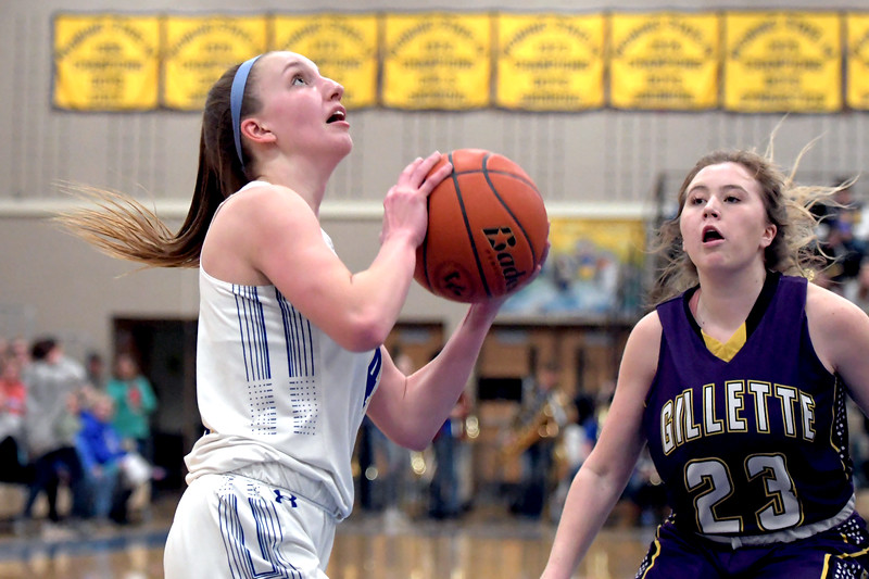 Joel Moline | The Sheridan Press<br /> Sheridan's Anni Mitzel (4) scores against Campbell County High School Friday, Feb. 21, 2020.