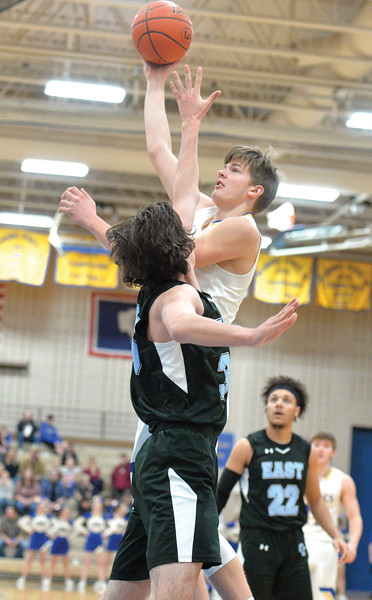 Bud Denega | The Sheridan Press<br /> Sheridan's Gus Wright rises for a hook shot during a game against Cheyenne East at Sheridan High School Feb. 2, 2018.