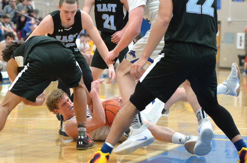 Bud Denega | The Sheridan Press<br /> Sheridan's Parker Christensen battles for a loose ball during a game against Cheyenne East at Sheridan High School Feb. 2, 2018.