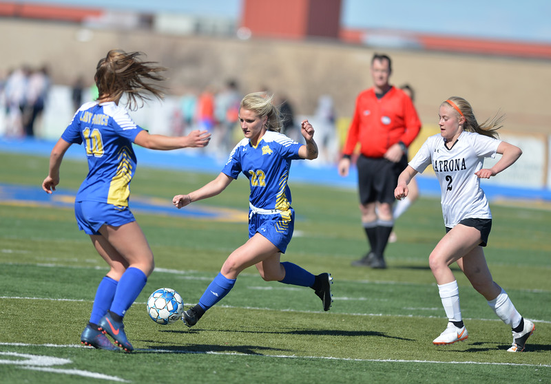 Bud Denega | The Sheridan Press<br /> Sheridan's Braylee Standish handles the ball during a game against Natrona County at Homer Scott Field Thursday, April 18, 2019.