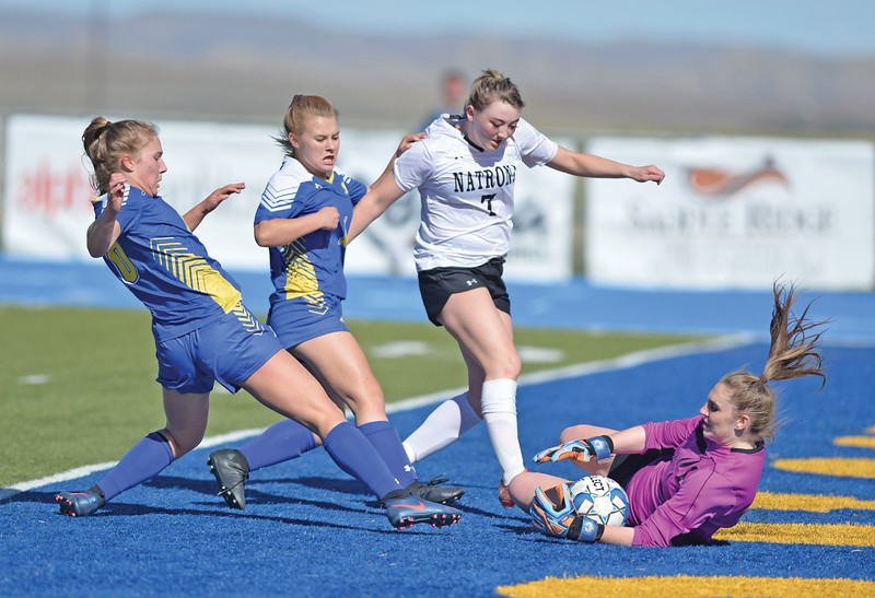 Bud Denega | The Sheridan Press<br /> Sheridan's Aria Heyneman, left, and Aubrey Cooper look to score during a game against Natrona County at Homer Scott Field Thursday, April 18, 2019.