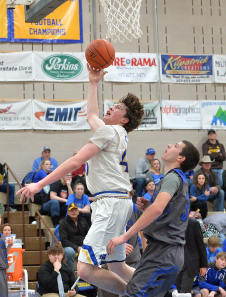 Bud Denega | The Sheridan Press<br /> Sheridan's Sam Lecholat goes in for a shot during the Broncs' game against Thunder Basin at Sheridan High School Saturday, Feb. 16, 2019.
