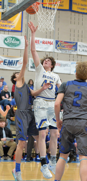 Bud Denega | The Sheridan Press<br /> Sheridan's Sam Lecholat rises for a shot during the Broncs' game against Thunder Basin at Sheridan High School Saturday, Feb. 16, 2019.