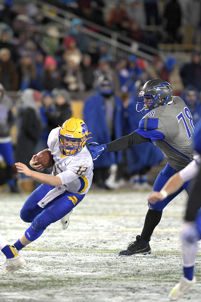 Matthew Gaston   The Sheridan Press<br>Sheridan's Jacob Boint (12) scrambles to avoid the sack by Thunder Basin's defensive tackle Dalton McInerney (78) during the 4A State Championship game Saturday, Nov. 16, 2019. The Broncs were victorious by a score 35-26.