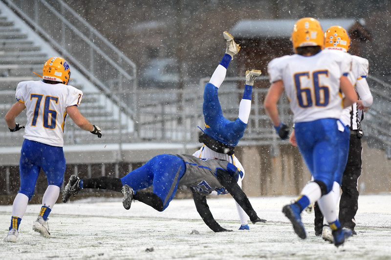 Matthew Gaston   The Sheridan Press<br>Sheridan's Carter Dubberley (7) is up-ended by Thunder Basin's Hunter Lunberg (32) after making an interception during the 4A State Championship game Saturday, Nov. 16, 2019.