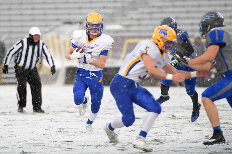Matthew Gaston   The Sheridan Press<br>Sheridan's Garrett Coon (5) clears a path for Izak Aksamit (11) at War Memorial Stadium for the state championship game against Thunder Basin Saturday, Nov. 16, 2019. Sheridan won 35-26.