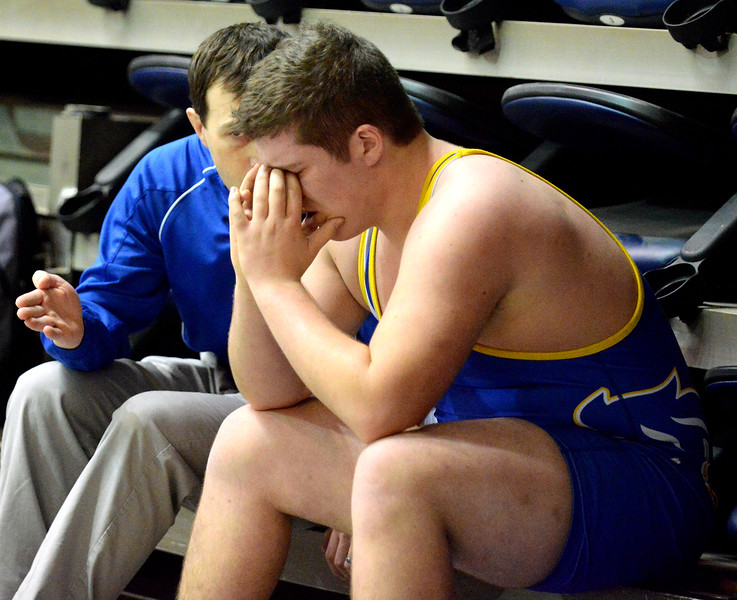 Ryan Patterson | The Sheridan Press<br /> Sheridan High School head coach Tyson Shatto consoles Ethan Johnson after a match at the State Wrestling Championships in the Casper Events Center Saturday, Feb. 24, 2018.