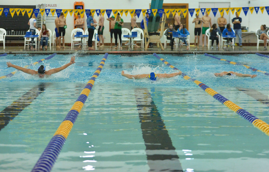 Justin Sheely | The Sheridan Press<br /> Sheridan swimmers, from left, Noah Hodges, Oscar Patten and Thomas Yates compete in the 100-meter butterfly during the last home swim meet at Sheridan Junior High School pool Friday, Jan 26, 2018.