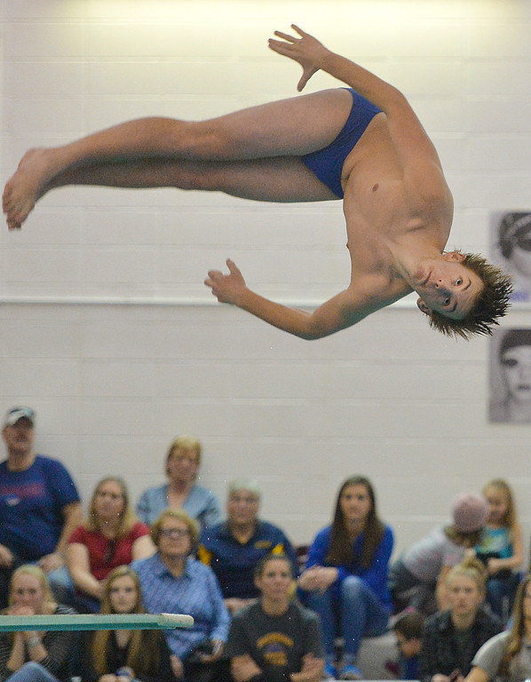 Justin Sheely | The Sheridan Press<br /> Sheridan's Emmett Potter competes in diving during the last home swim meet at Sheridan Junior High School pool Friday, Jan 26, 2018.