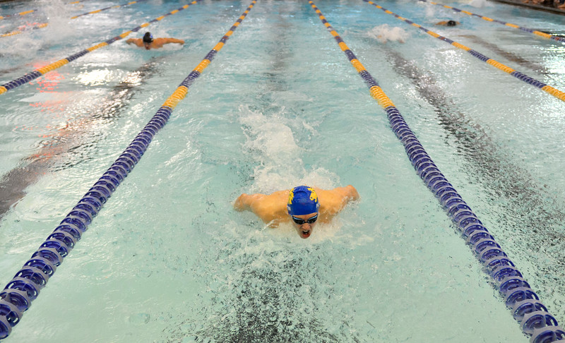 Justin Sheely | The Sheridan Press<br /> Sheridan's Oscar Patten powers ahead of his teammates in the 100-meter butterfly during the last home swim meet at Sheridan Junior High School pool Friday, Jan 26, 2018. Patten broke the 1985 school record after finishing in 1 minute and .18 seconds.