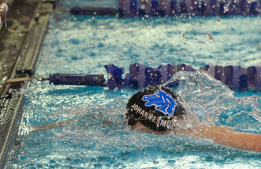 Justin Sheely | The Sheridan Press<br /> Sheridan's Caleb Johannesmeyer finishes for a top time of 2 minutes and 29.34 seconds in the 200-meter IM during the last home swim meet at Sheridan Junior High School pool Friday, Jan 26, 2018.