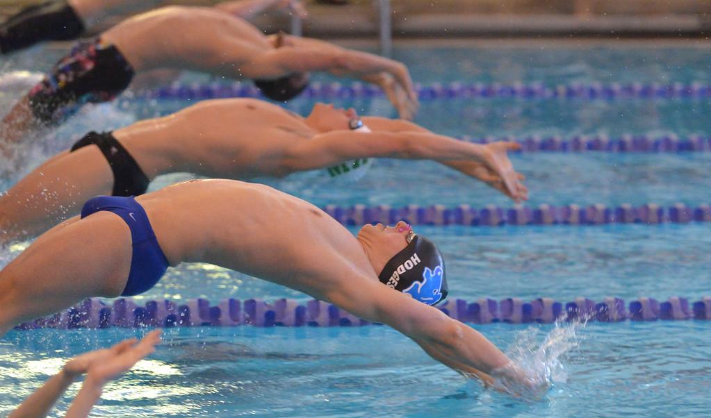Justin Sheely | The Sheridan Press<br /> Sheridan's Noah Hodges pushes off the block in the 200-meter medley relay during the last home swim meet at Sheridan Junior High School pool Friday, Jan 26, 2018.