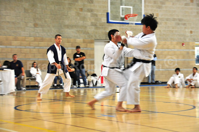 Don't know what he was doing. Letting go of his guard or something.  Shinkyu Shotokan Karate Tournament, South San Francisco.