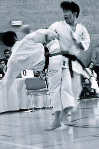 Ok. I see Ekapol was trying to close the distance and getting his backfist in there.  Shinkyu Shotokan Karate Tournament, South San Francisco.