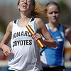be0402trak02<br /> Monarch's Maddie Alm brought her team in second just ahead of Broomfield's Cherokee Rohrbaugh in the 4X800 relay during the Broomfield Shoot Out Track Meet at Elizabeth Kennedy Stadium on Friday..<br /> April 1, 2011<br /> staff photo/David R. Jennings