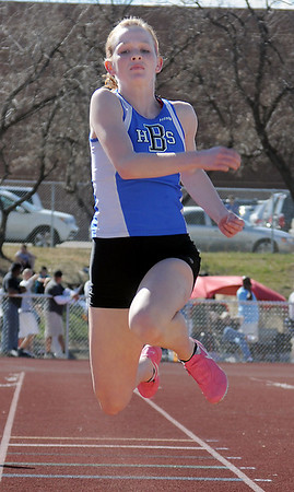 be0402trak14<br /> Broomfeild's Sarah Hughes in the triple jump during the Broomfield Shoot Out Track Meet at Elizabeth Kennedy Stadium on Friday..<br /> April 1, 2011<br /> staff photo/David R. Jennings