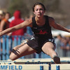 be0402trak08<br /> Fairview's Justine Sherman running in the 100 meter hurdles event during the Broomfield Shoot Out Track Meet at Elizabeth Kennedy Stadium on Friday..<br /> April 1, 2011<br /> staff photo/David R. Jennings