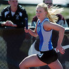 be0402trak17<br /> Broomfield's Kate Summerfield running in the 800 medley relay during the Broomfield Shoot Out Track Meet at Elizabeth Kennedy Stadium on Friday..<br /> April 1, 2011<br /> staff photo/David R. Jennings
