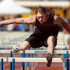 be0402trak09<br /> Boulder's MacKenzie Felkley running in the 110m high hurdles during the Broomfield Shoot Out Track Meet at Elizabeth Kennedy Stadium on Friday..<br /> April 1, 2011<br /> staff photo/David R. Jennings
