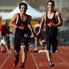 be0402trak11<br /> Fairveiw's Ben Meyer, center, slows down with an injury in the 100m dash during the Broomfield Shoot Out Track Meet at Elizabeth Kennedy Stadium on Friday..<br /> April 1, 2011<br /> staff photo/David R. Jennings