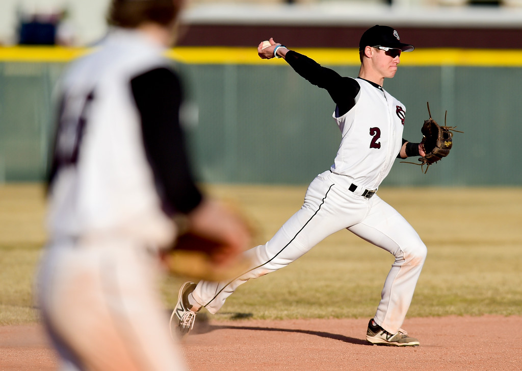. Silver Creek High School\'s Spencer Rich (No. 2) throws to first for an out against Broomfield High School in Longmont, Colorado on March 12, 2018. (Photo by Matthew Jonas/Staff Photographer)