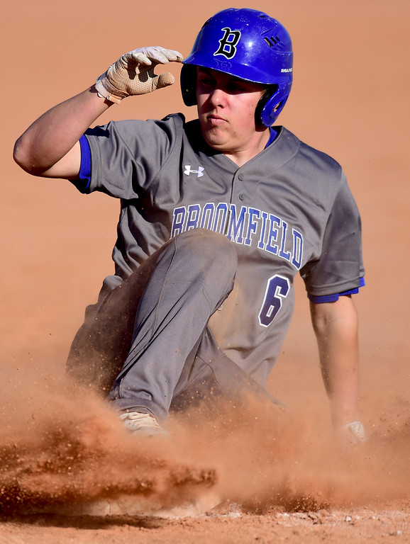 . Broomfield High School\'s Ross Lawnhurst (No. 6) slides safely in to third base in the game against Silver Creek High School in Longmont, Colorado on March 12, 2018. (Photo by Matthew Jonas/Staff Photographer)