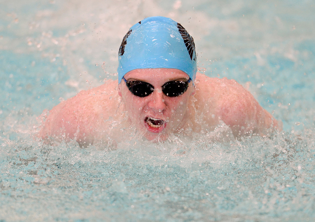 . Longmont High School\'s JT Sears swims in the 100 Yard Butterfly event in a meet with Silver Creek High School in Longmont, Colorado on April 12, 2018. (Photo by Matthew Jonas/Staff Photographer)