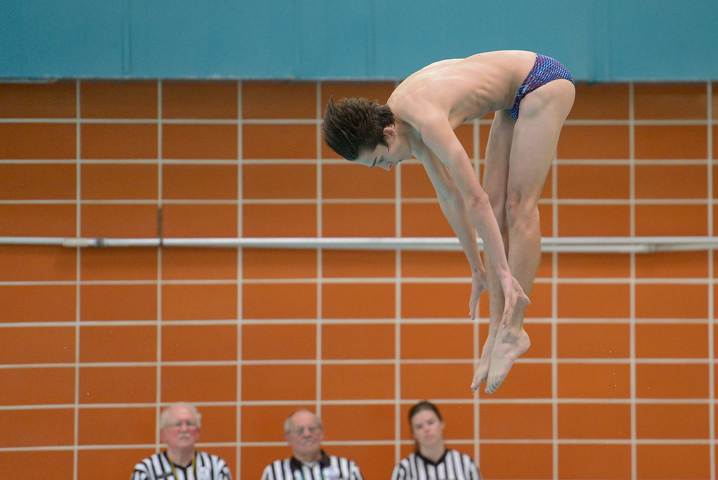 . Longmont High School\'s Cooper Welsh dives during a meet with Silver Creek High School in Longmont, Colorado on April 12, 2018. (Photo by Matthew Jonas/Staff Photographer)