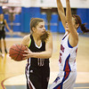 S0109BASKET6<br /> Silver Creek's #11, Taylor Strub, works the ball into the paint as Centarus'# 15, Midori Patterson, defends during their game at Centarus High School on Tuesday evening, January 8th, 2013.<br /> <br /> Photo by: Jonathan Castner