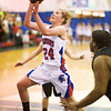 S0109BASKET5<br /> Centarus' #24, Lauren Esler, flies to the hoop during their game against Silver Creek at Centarus High School on Tuesday evening, January 8th, 2013.<br /> <br /> Photo by: Jonathan Castner
