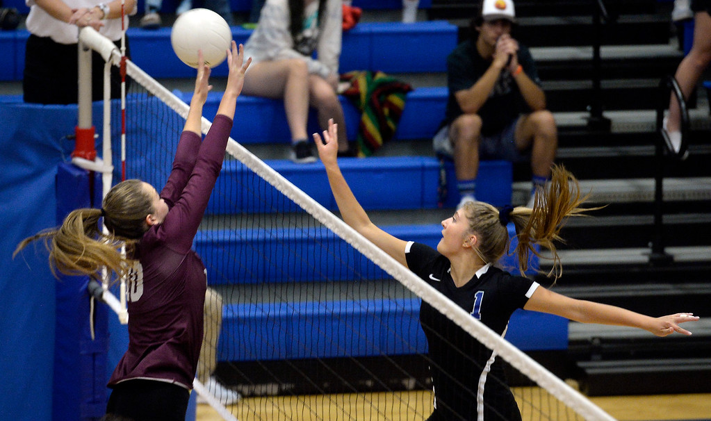 . LONGMONT, CO: September 18: Longmont\'s Caroline Demosthenes trie to hit past Silver Creek\'s Caitlin Volkmann. Silver Creek played Longmont at LHS on September 18, 2018.  (photo by Cliff Grassmick/Staff Photographer).