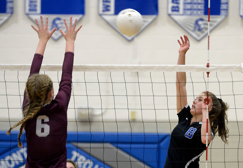 . LONGMONT, CO: September 18: Longmont\'s Ada Grace Creighton, tries to get the ball over Silver Creek\'s Margaret Adams. Silver Creek played Longmont at LHS on September 18, 2018.  (photo by Cliff Grassmick/Staff Photographer).