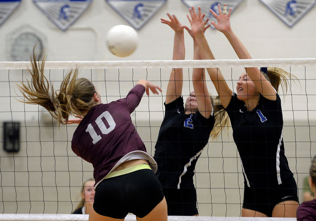 . LONGMONT, CO: September 18:  Silver Creek\'s Caitlin Volkmann tries to hit past  Longmont\'s Annika Wetterstrom, left, and Caroline Demosthenes. Silver Creek played Longmont at LHS on September 18, 2018.  (photo by Cliff Grassmick/Staff Photographer).