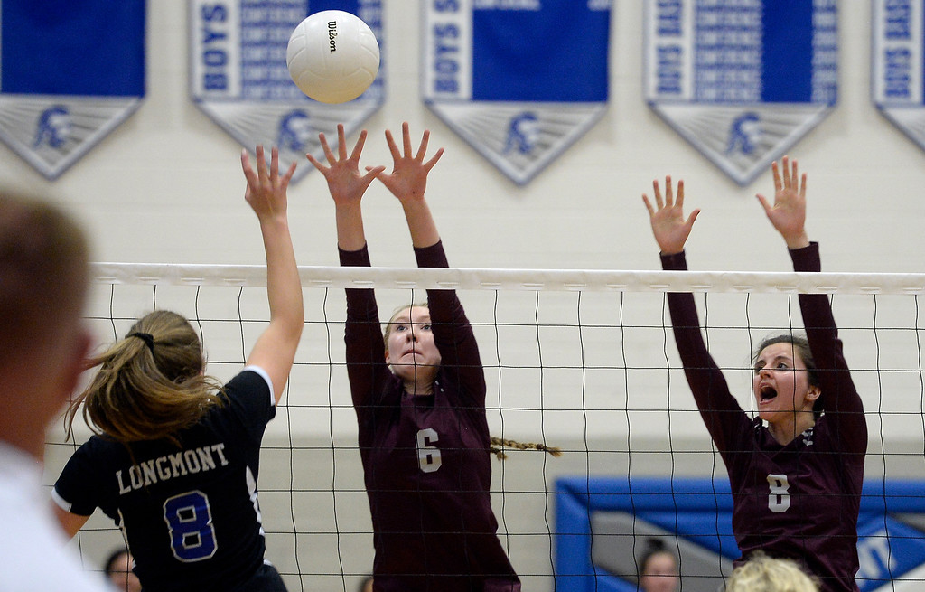 . LONGMONT, CO: September 18: Longmont\'s Ada Grace Creighton tries to get the ball over Silver Creek\'s Margaret Adams, left, and Gabi Eisenberg. Silver Creek played Longmont at LHS on September 18, 2018.  (photo by Cliff Grassmick/Staff Photographer).