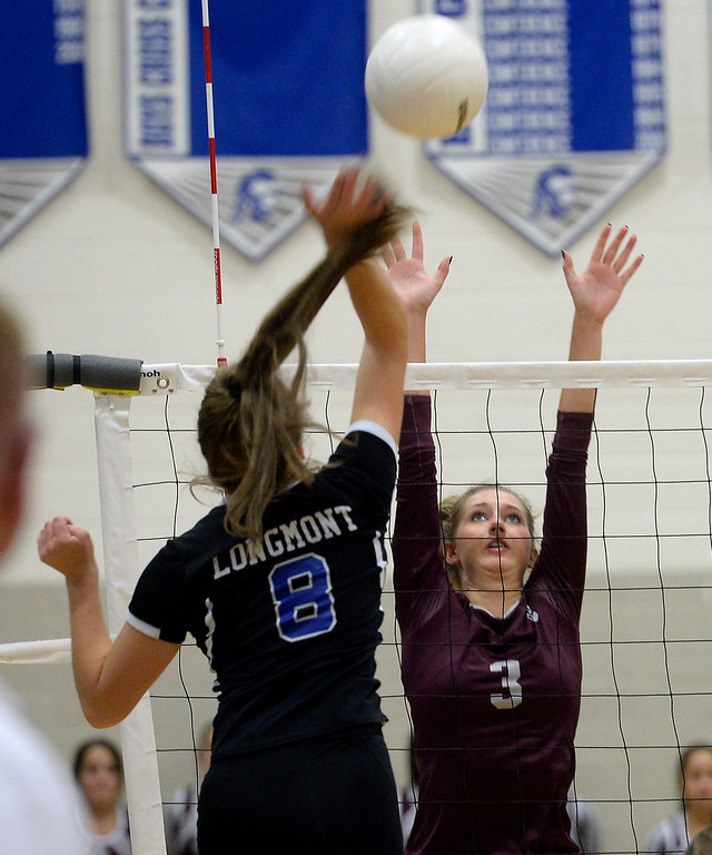 . LONGMONT, CO: September 18: Longmont\'s Ada Grace Creighton hits over Silver Creek\'s Emily Churchich. Silver Creek played Longmont at LHS on September 18, 2018.  (photo by Cliff Grassmick/Staff Photographer).