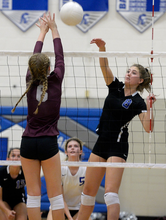 . LONGMONT, CO: September 18: Longmont\'s Ada Grace Creighton hits over Silver Creek\'s Margaret Adams. Silver Creek played Longmont at LHS on September 18, 2018.  (photo by Cliff Grassmick/Staff Photographer).