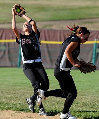 Mackenzie Wergin of Silver Creek gets the catch near a teammate.<br /> Cliff Grassmick / September 2, 2010