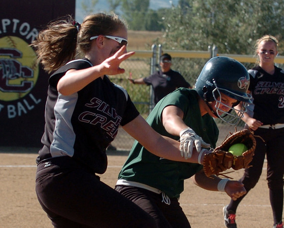 "Keil Shelby, left, of Silver Creek, collides with the runner, Rachel Johnson of Niwot. Johnson was called out.<br />  For more photos of the game, go to  <a href=""http://www.dailycamera.com"">http://www.dailycamera.com</a>.<br /> Cliff Grassmick / September 2, 2010"