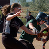 """Keil Shelby, left, of Silver Creek, collides with the runner, Rachel Johnson of Niwot. Johnson was called out.<br />  For more photos of the game, go to  <a href=""""http://www.dailycamera.com"""">http://www.dailycamera.com</a>.<br /> Cliff Grassmick / September 2, 2010"""