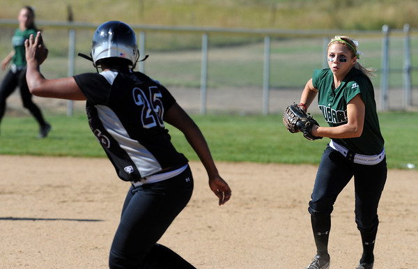 "Symone Loomis-Dotson of Silver Creek gets caught in a run down by  Taylor Supino of Niwot.<br />  For more photos of the game, go to  <a href=""http://www.dailycamera.com"">http://www.dailycamera.com</a>.<br /> Cliff Grassmick / September 2, 2010"