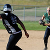 """Symone Loomis-Dotson of Silver Creek gets caught in a run down by  Taylor Supino of Niwot.<br />  For more photos of the game, go to  <a href=""""http://www.dailycamera.com"""">http://www.dailycamera.com</a>.<br /> Cliff Grassmick / September 2, 2010"""