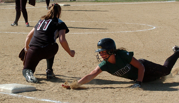 "Ashley Silva of Niwot gets back to first before the tag of Keil Shelby of Siver Creek.<br />  For more photos of the game, go to  <a href=""http://www.dailycamera.com"">http://www.dailycamera.com</a>.<br /> Cliff Grassmick / September 2, 2010"