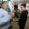 Silver Mittens boxers training at West End Gym. Art Ramalho with Duni Morales, 13, of Lowell, who will box at 125 lbs. (SUN/Julia Malakie)