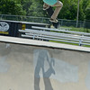 Instructor Taylor Clarke, 18, of Leominster, performs a trick during the 10th Annual Skate Camp at Ryan C. Joubert Memorial Skate Park in Fitchburg on Monday afternoon. SENTINEL & ENTERPRISE / Ashley Green