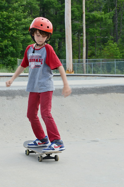 Joseph Hansen, 10 of Fitchburg, performs a trick during the 10th Annual Skate Camp at Ryan C. Joubert Memorial Skate Park in Fitchburg on Monday afternoon. SENTINEL & ENTERPRISE / Ashley Green