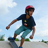 Xavier Khan, 12, of Fitchburg, performs a trick during the 10th Annual Skate Camp at Ryan C. Joubert Memorial Skate Park in Fitchburg on Monday afternoon. SENTINEL & ENTERPRISE / Ashley Green