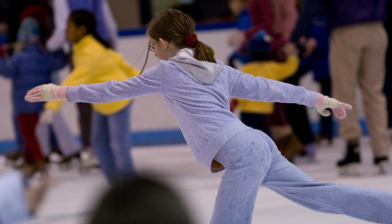She glides through the crowded rink.