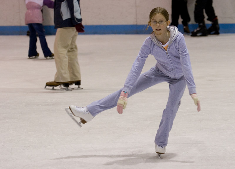 She pulls into a sit spin. Because of the chin injury and the crowds, she had to restrain her spins and jumps.