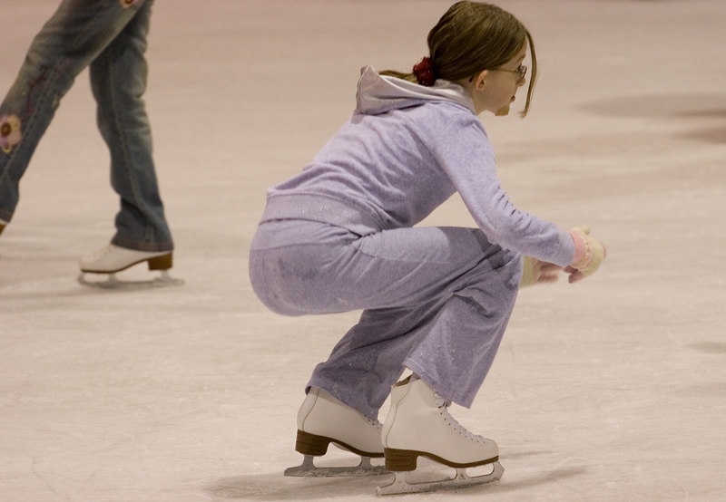 The weary skater momentarily rests.