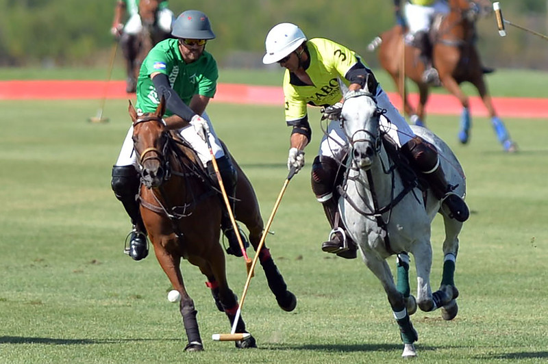 Joel Moline | The Sheridan Press<br /> Miguel Astrada moving the ball down the field with defender Nicolai Galindo close behind him during the Skeeter Johnnson Cup Final at the Flying H Polo Club Thursday, Aug. 3, 2019.
